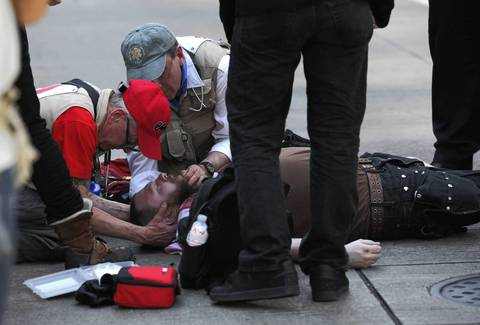A protester who appeared to suffer a seizure is assisted.