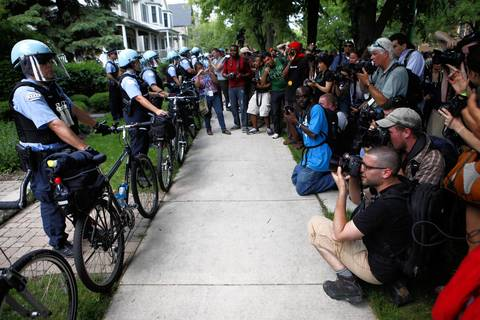 Photographers document the police in front of Mayor Rahm Emanuel's North Side home during a protest targeting the NATO Summit and city health care cuts.