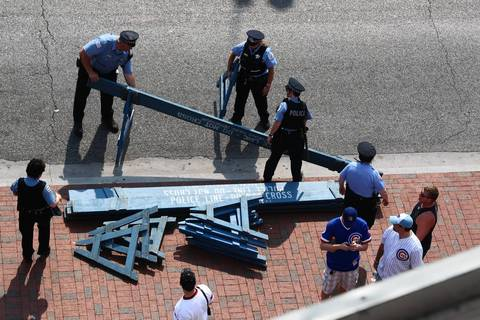 Police set up barricades at Wrigley Field in preparation for protesters.