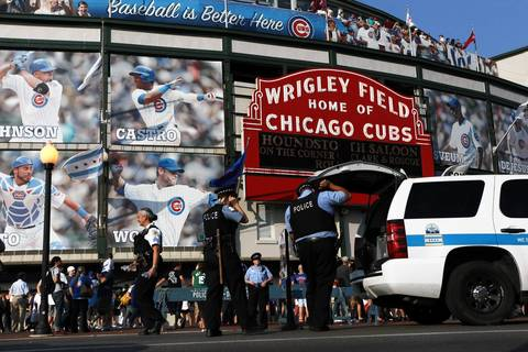 Police gather before outside Wrigley Field.