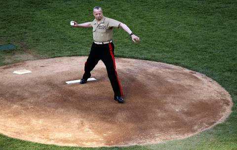 USMC General John R. Allen throws out the ceremonial first pitch.