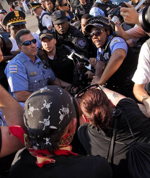 Protestors and police scuffle, leading to an arrest at Michigan Avenue and 18th Street.