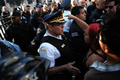 A female protester makes a point to police.
