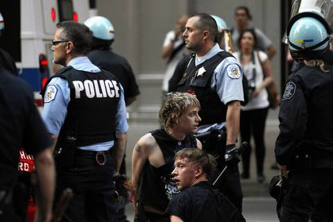 Police arrest protesters near the corner of Washington and State Streets in the Loop during an evening NATO Summit-related protest in Chicago.