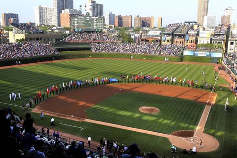 International flags are displayed at Wrigley Field during a NATO-themed pregame ceremony.