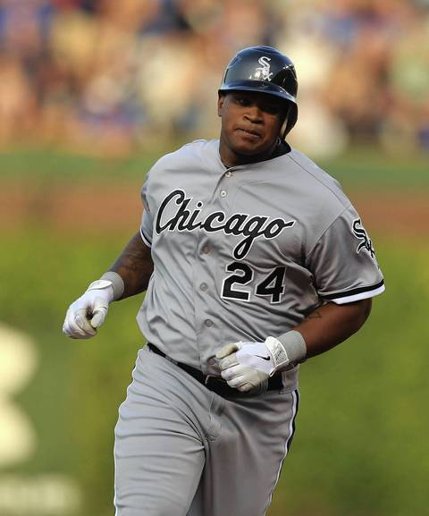 Dayan Viciedo does his home run trot in the 3rd inning that also scored Adam Dunn.