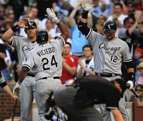 Dayan Viciedo is greeted at home plate by Adam Dunn and A.J. Pierzynski following his 2-run HR with Dunn aboard in the 3rd.
