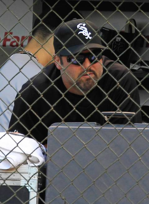 Paul Konerko watches from the White Sox dugout.