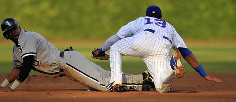 Alejandro DeAza steals second base in the 1st inning, after the late tag by the Cubs' Starlin Castro.