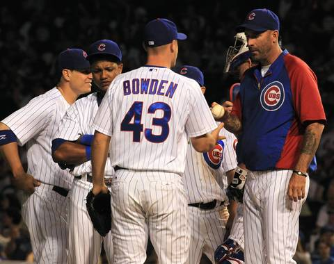 Cubs manager Dale Sveum goes to pitcher Michael Bowden in the 8th inning.