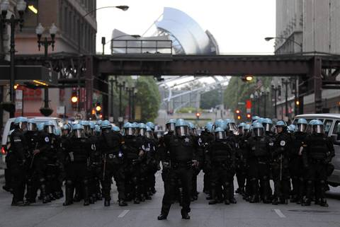 Chicago Police line up on Washington Street near Wabash Avenue as anti-NATO protesters march through the streets of Chicago on Saturday evening.