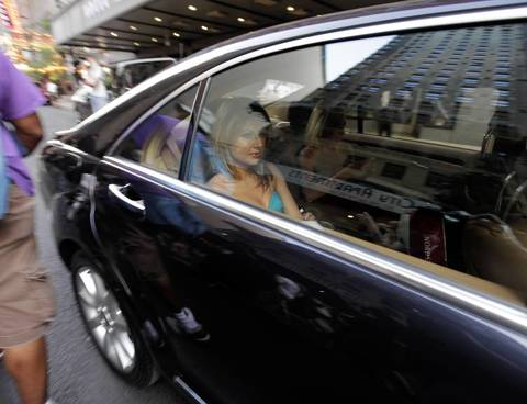 A woman in a car is delayed as anti-NATO protesters march through the streets of Chicago on Saturday night.