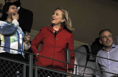 U.S. Secretary of State Hillary Clinton shows a smile in skybox Saturday night at Wrigley Field as the Chicago Cubs host the Chicago White Sox.