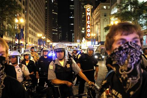 Chicago police block protesters from moving north on State Street in downtown Chicago.