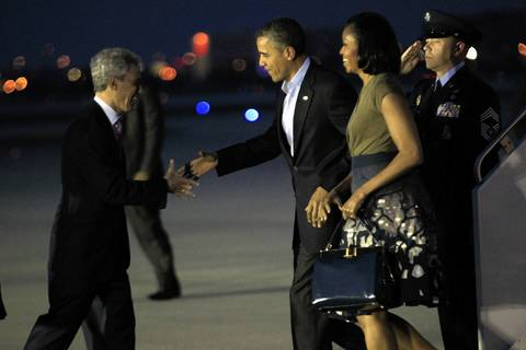 Chicago Mayor Rahm Emanuel, left, greets President Obama and wife Michelle on the tarmac at O'Hare International Airport Saturday, night, one day before the start of the NATO summit meetings in Chicago.
