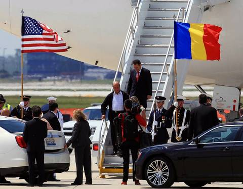 Romanian President Traian Basescu, left on stairway, arrives at Chicago O'Hare International Airport for the start of the NATO Summit.