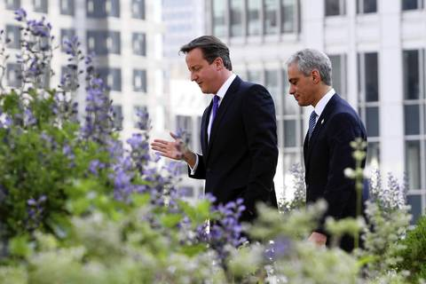 Mayor Rahm Emanuel meets with British Prime Minister David Cameron, left, and toured the rooftop garden at City Hall.