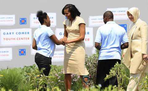 First Lady Michelle Obama talks with participants in the Youth Urban Agriculture Program along with Hayrunnisa Gul, wife of Turkey's president, far right, at the Gary Comer Youth Center on Chicago's South Side.