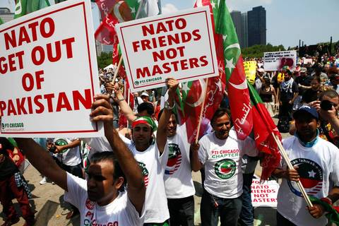 Members of Pakistan Tehreh-e-Insaf (PTI) Chicago join protesters in Grant Park for an anti-war march and rally.