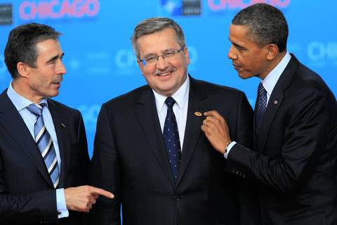NATO Secretary General Anders Fogh Rasmussen, left, Polish President Bronislaw Komorowski, center, and President Barack Obama talk to each other during a media appearance at McCormick Place during the NATO 2012 Summit.