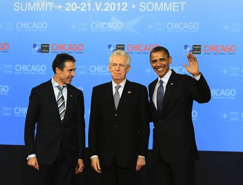 NATO Secretary General Anders Fogh Rasmussen, left, Italian Prime Minister Mario Monti, center, and President Barack Obama greet the media at McCormick Place during the NATO 2012 Summit.