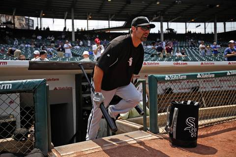 Paul Konerko runs out of the dugout for batting practice.