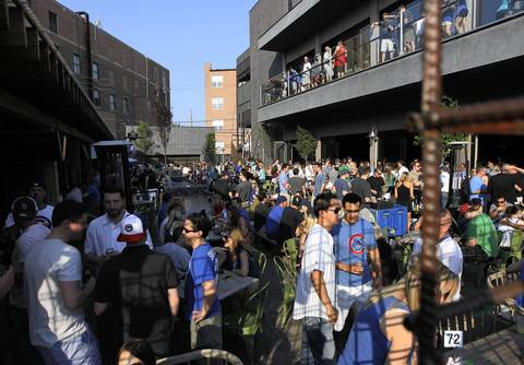 Cubs fans pack the patio at Deuces along Clark Street in Wrigleyville.
