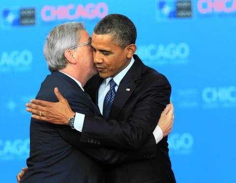 Prime Minister of Luxembourg Jean-Claude Juncker breaks protocol and gives U.S. President Barack Obama a big hug and kiss during a welcome ceremony for North Atlantic Council Leaders at the 2012 NATO Summit.