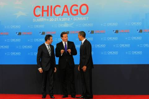 David Cameron, Prime Minister of the United Kingdom, center, speaks with NATO Secretary General Anders Fogh Rasmussen, left, and President Barack Obama, during a welcome ceremony for North Atlantic Council Leaders at the 2012 NATO Summit.