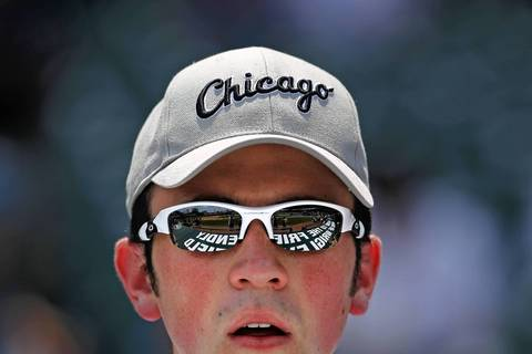 White Sox fan Matt Brozovic watches batting practice.