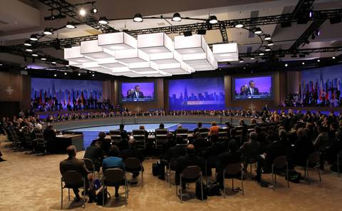 U.S. President Barack Obama welcomes attendees as he speaks at the opening session of the North Atlantic Council at the 2012 NATO Summit.