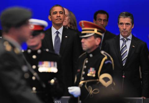 U.S. President Barack Obama and NATO Secretary General Anders Fogh Rasmussen stand at attention during opening ceremonies of the 2012 NATO Summit.