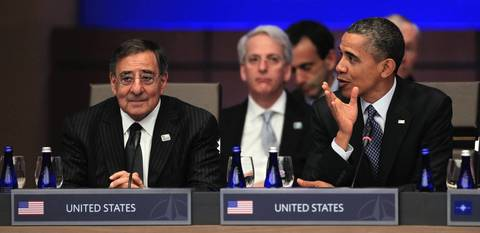 U.S. President Barack Obama, right, sits with U.S. Secretary of Defense Leon Panetta at the opening session of the North Atlantic Council. Behind them is Ivo Daalder, U.S. Ambassador to NATO.
