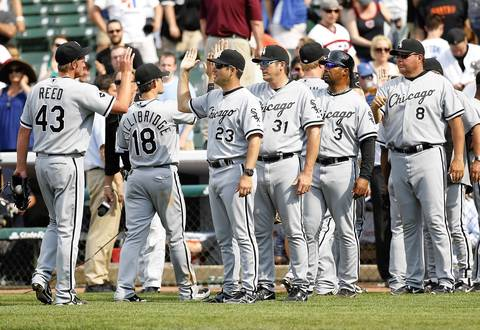 Manager Robin Ventura, coaches and Sox players celebrate a 6-0 win over the Cubs.