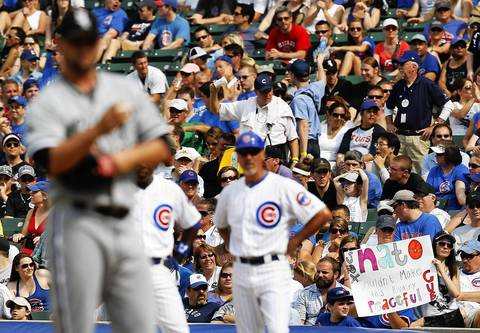 A fan makes a statement with her sign as relief pitcher Jesse Crain pitches in the eighth inning.