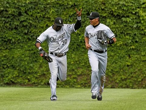 Center fielder Alejandro De Aza and left fielder Kosuke Fukudome celebrate the 6-0 win.