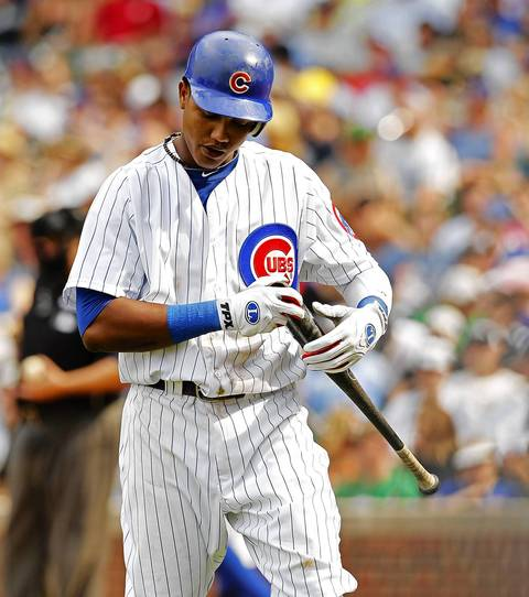 Starlin Castro walks back to the dugout after striking out swinging in the eighth inning.