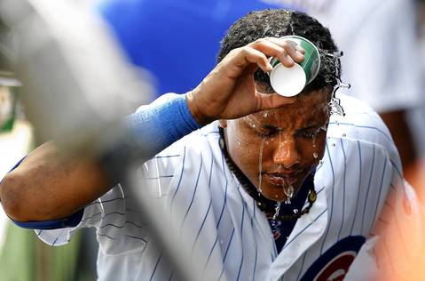 Starlin Castro keeps cool in the dugout in between innings.