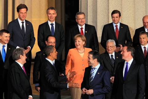 U.S. President Barack Obama talks with NATO leaders including French president Francois Hollande, middle row - second left, German Chancellor Angela Merkel, middle row - third left, NATO Secretary General Anders Fogh Rasmussen, bottom row - third left, and British Prime Minister David Cameron at Soldier Field.