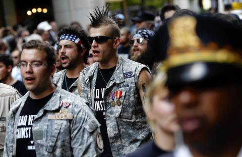 Military veterans march with anti-NATO protesters through the Loop.