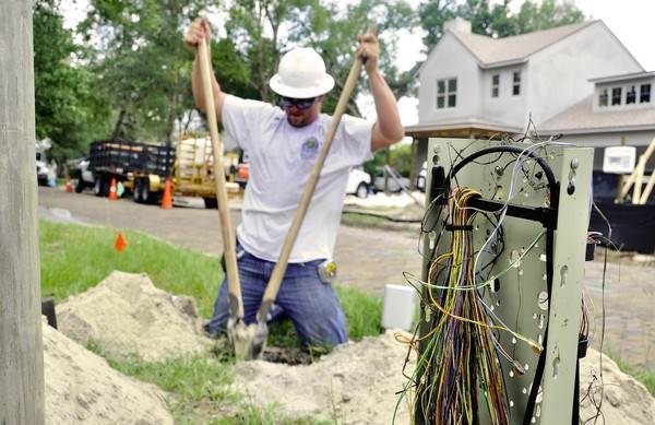 "Foreman Vernon ""Moo"" Mummaw, 29, digs a hole along Magnolia Avenue in Winter Park on Thursday. Mummaw's team laid 130 feet of electrical conduit Thursday as part of a larger city project to move utilities underground."