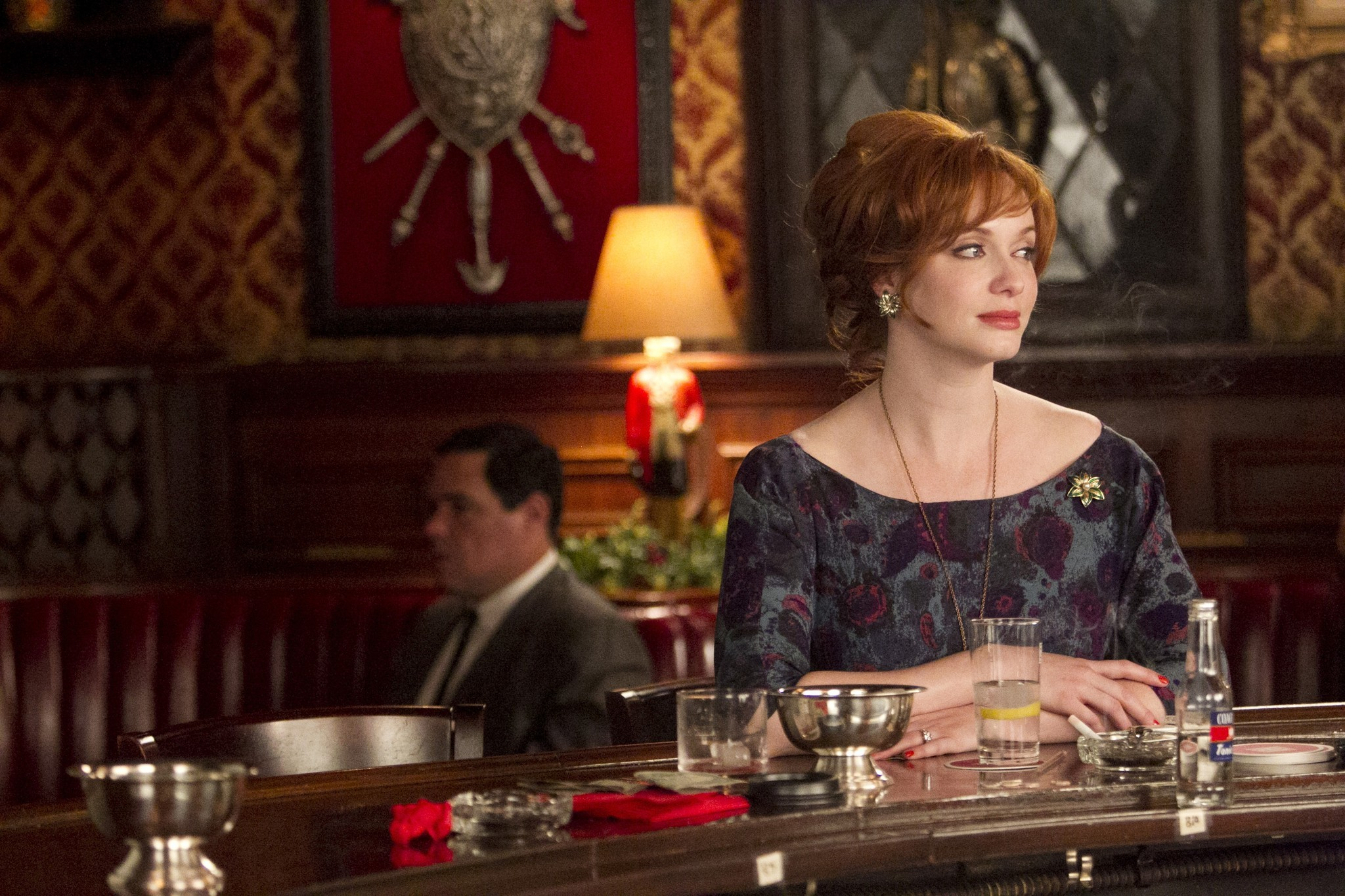 Joan Harris (Christina Hendricks) needs a good, stiff drink.