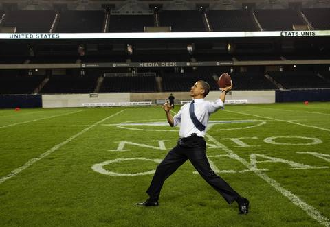 President Barack Obama throws a football at Soldier Field following the NATO working dinner in Chicago.