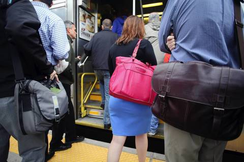 Metra passengers did not have any problems carrying bags, satchels or backpacks on board inbound Metra trains from Route 59 Station in Aurora, despite Metra's stated restrictions on certain items during the NATO Summit.