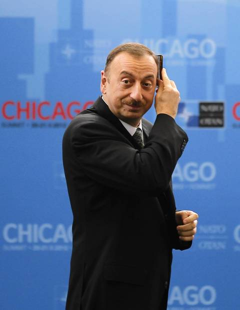 President of Azerbaijan Ilham Heydar combs his hair as he arrives for an International Security Assistance Force meeting.