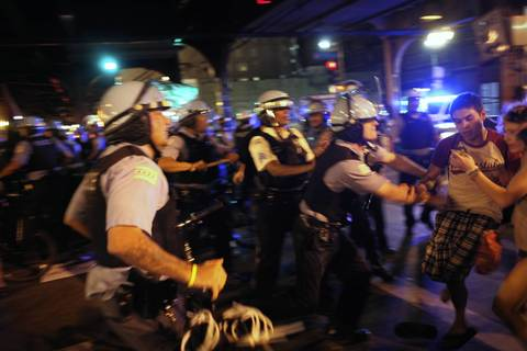 Chicago police and protesters clash at VanBuren Street and Wabash Avenue.