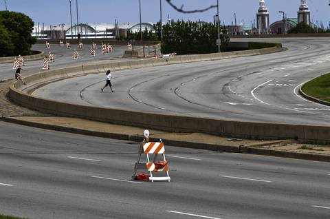 Joggers cross empty Lake Shore Drive near Randolph Street in Chicago. Portions of Lake Shore Drive are closed during the NATO Summit.