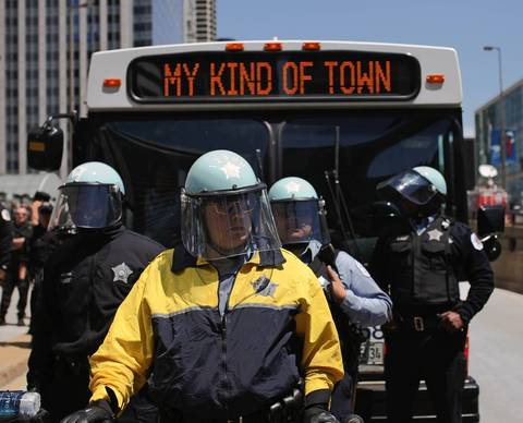 Police wear protective headgear for the march by protestors from Union Park to Boeing headquarters for a rally and then to President Barack Obama's campaign headquarters.