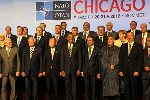 President Barack Obama, center, is flanked by U.N. Secretary-General Ban Ki-moon, left, and NATO Secretary-General Anders Fogh Rasmussen, right, during a photo of the heads of state at the NATO summit held at McCormick Place in Chicago. Afghan President Hamid Karzai is pictured next to Rasmussen.