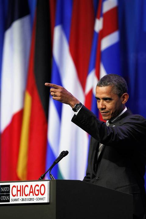 """President Barack Obama points to the back and says, """"White Sox fan in the back, right on,"""" as he started his 2012 NATO wrap-up press conference talking about the crosstown rivalry games played last weekend between the Chicago White Sox and Cubs."""